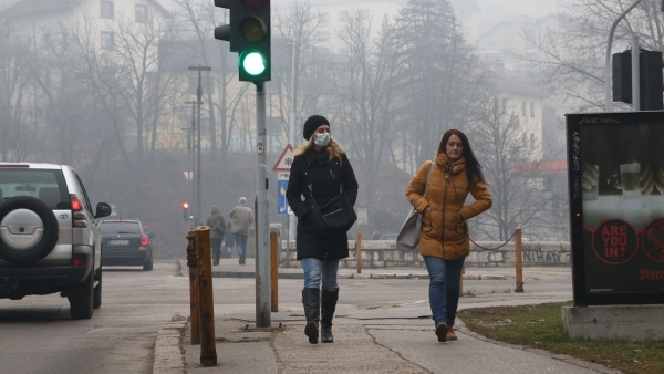 Air Pollution: People walk on the streets of Sarajevo - the capital of Bosnia and Herzegovina wearing masks so as to avoid breathing polluted air.