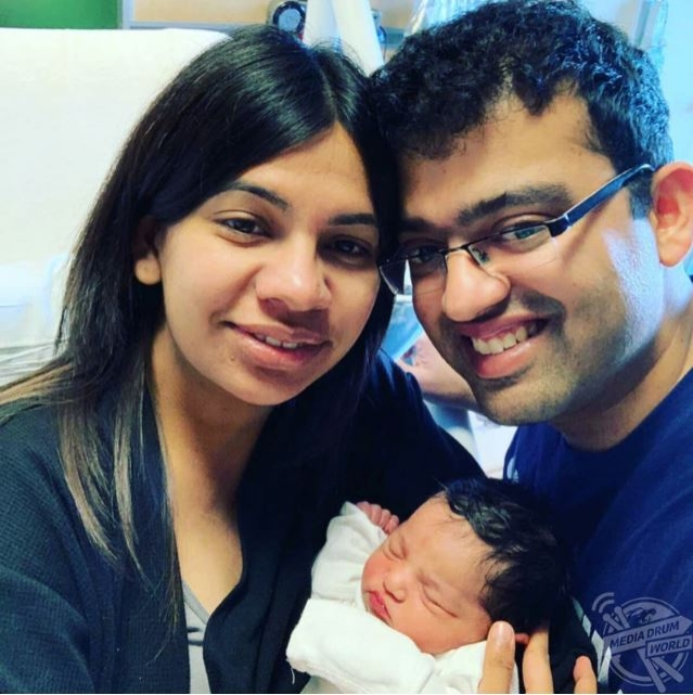 Revati and her husband with their daughter.
