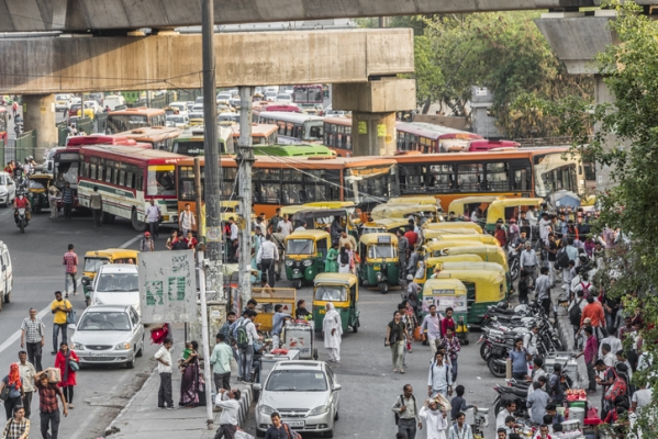 Big trafic with TukTuks, buses and people in New-Delhi, India