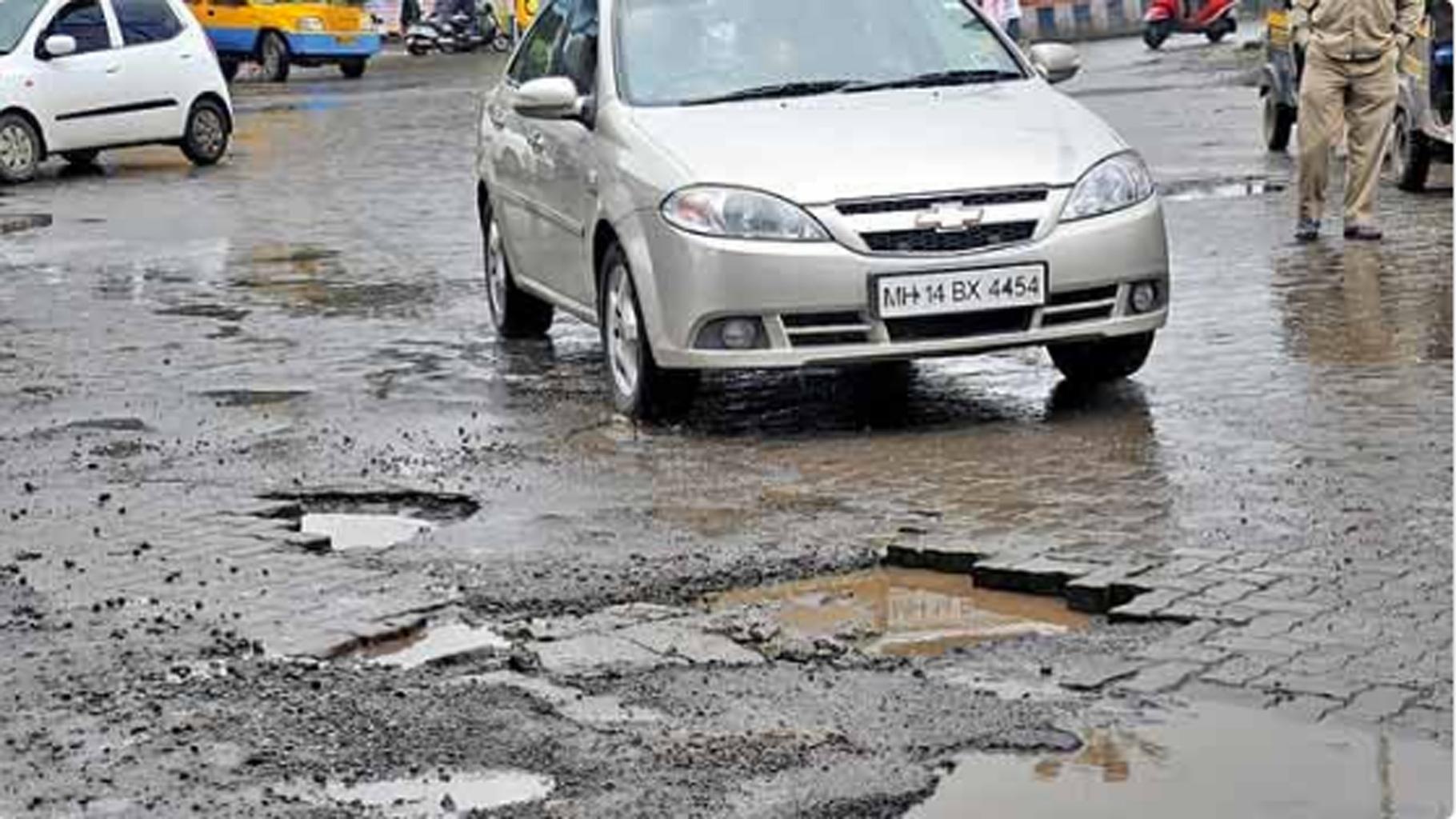 Image result for mumbai western express highway potholes