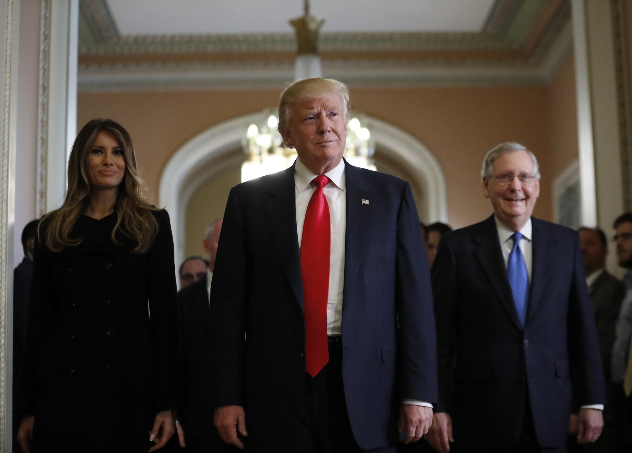 President-elect Donald Trump and his wife Melania walk with Senate Majority  Leader Mitch McConnell
