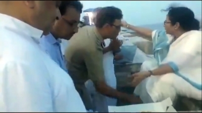 Viral video of top IPS officer touching Mamata's feet
