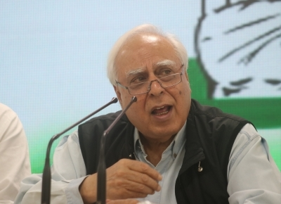 Sibal tears into government as it completes 100 days