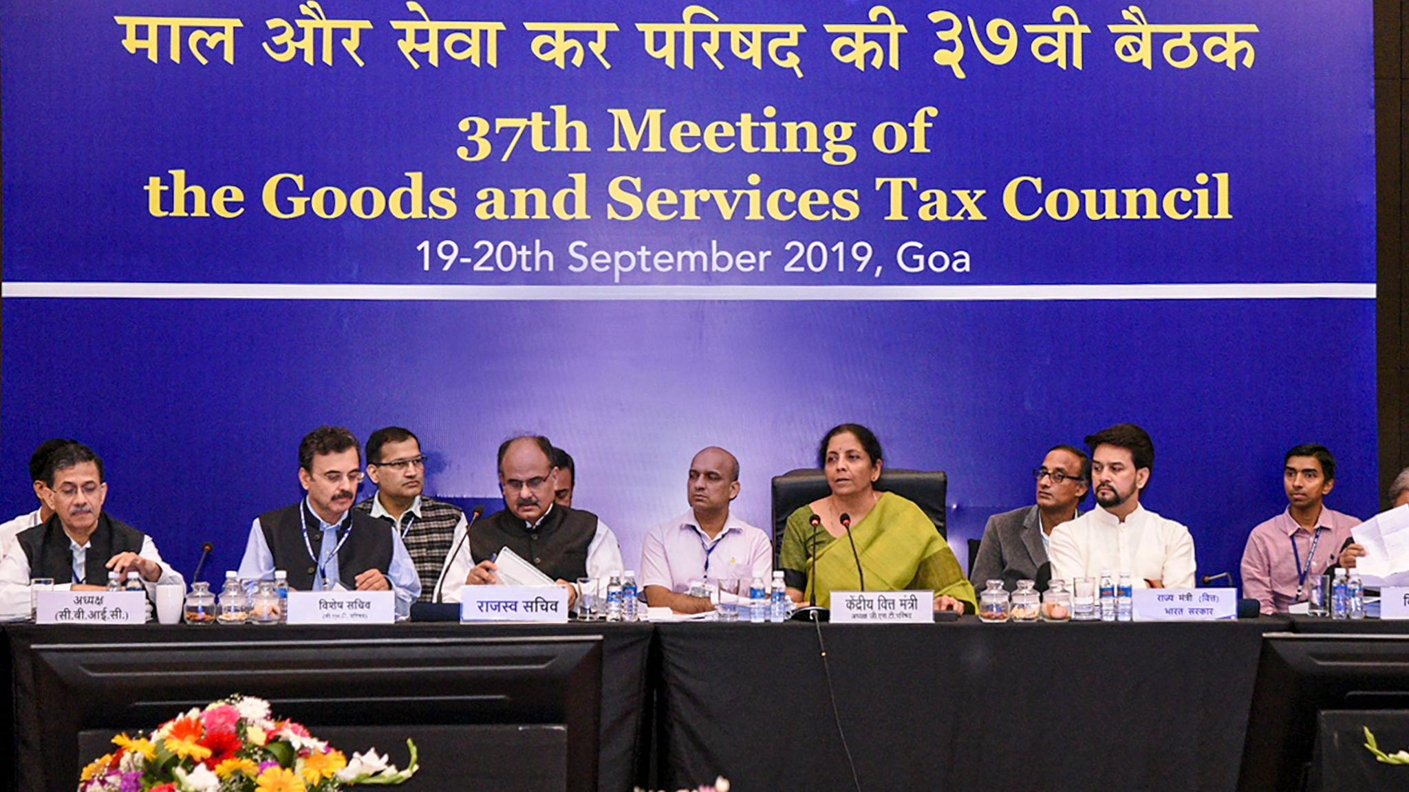QBiz: GST Council Lowers Tax Rates; FinMin Slashes Corporate Tax