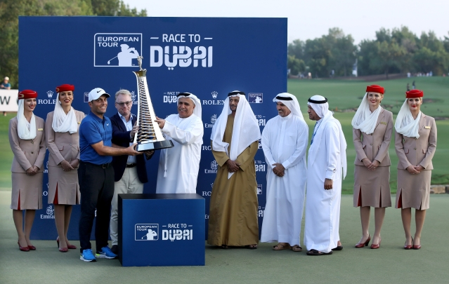 Francesco Molinari is handed his trophy