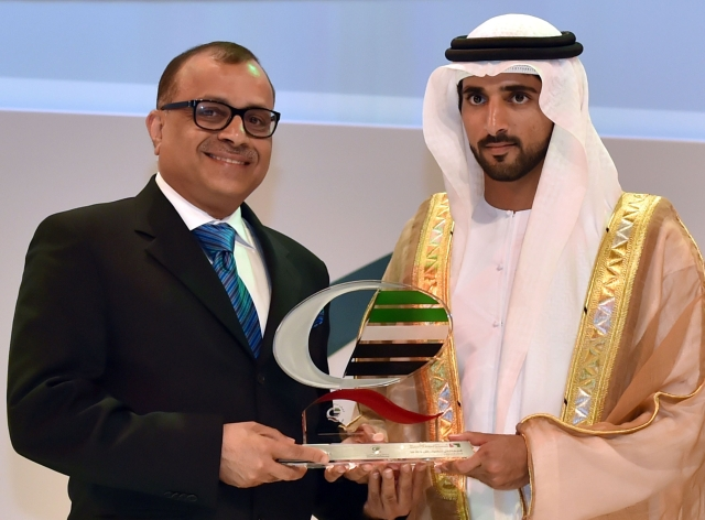Eugene Mayne receiving the  Dubai Quality Appreciation Award from Crown Prince of Dubai, Sheikh Hamdan bin Mohammed bin Rashid Al Maktoum.