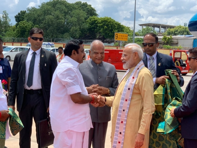 Prime Minister Narendra Modi being welcomed by Tamil Nadu Governor Banwarilal Purohit and Chief Minister Edappadi K. Palaniswami on his arrival in Chennai
