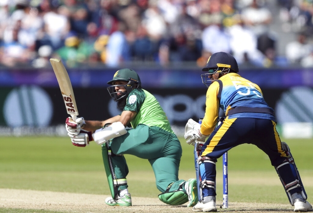 South Africa's batsman Hashim Amla, left, watches his shot.