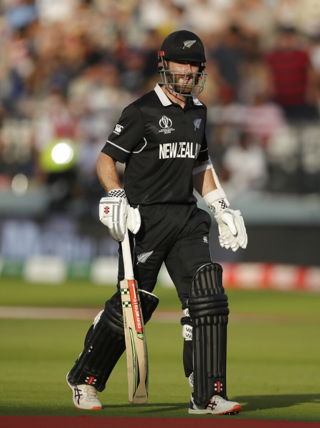 Kane Williamson walks off the pitch after being given out.