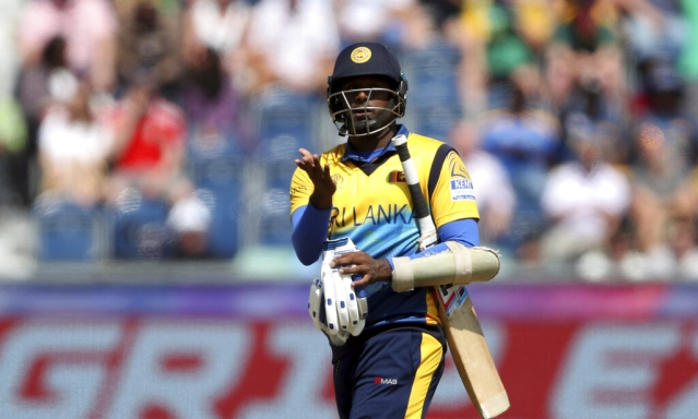 Angelo Mathews reacts as he leaves the crease after being bowled by South Africa's bowler Chris Morris for 30 runs.