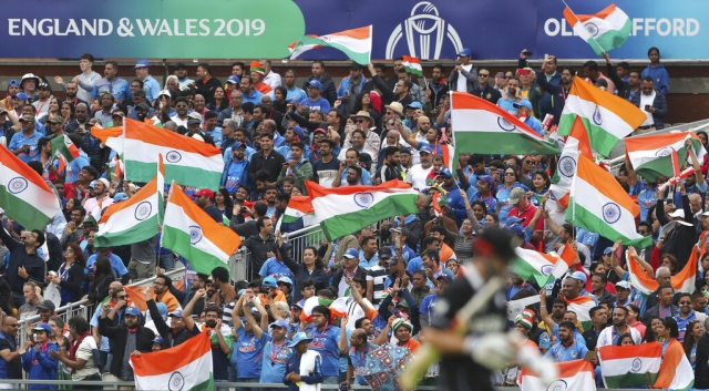 Indian supporters celebrate the dismissal of New Zealand's captain Kane Williamson.
