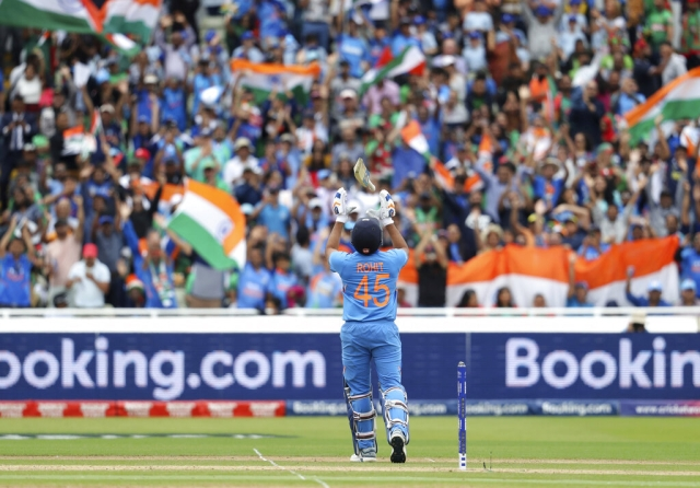 India's Rohit Sharma celebrates after scoring a century during the Cricket World Cup match between India and Bangladesh.