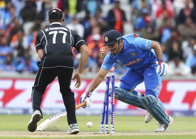 India's Mahendra Singh Dhoni is run out during the Cricket World Cup semifinal match between India and New Zealand at Old Trafford in Manchester.