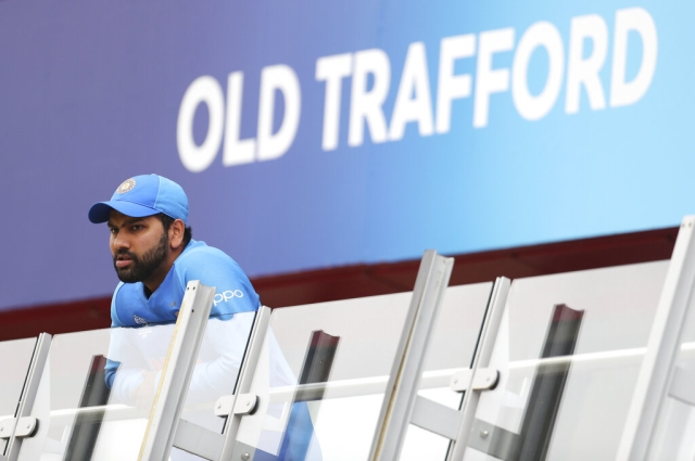 India's Rohit Sharma stands outside team's dressing room as he watches the Cricket World Cup semi-final match
