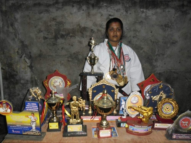 Sangeetha with her medals and awards