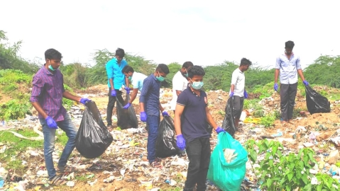 Young people disposing of plastic trash in palaru river