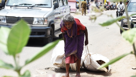 A 75-year elder woman collecting empty boxes for livelihood