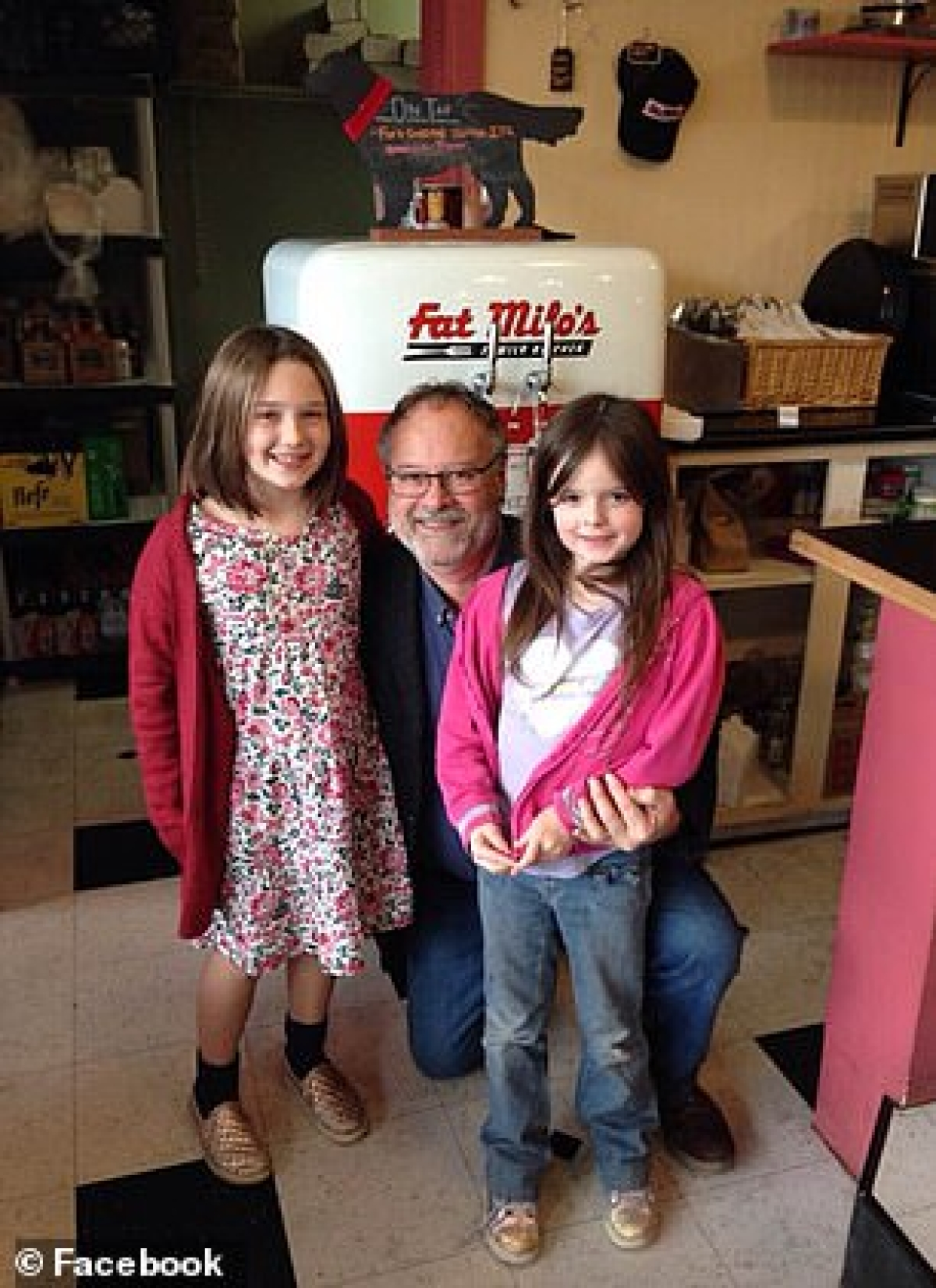 Doug Hayes with his grand daughters