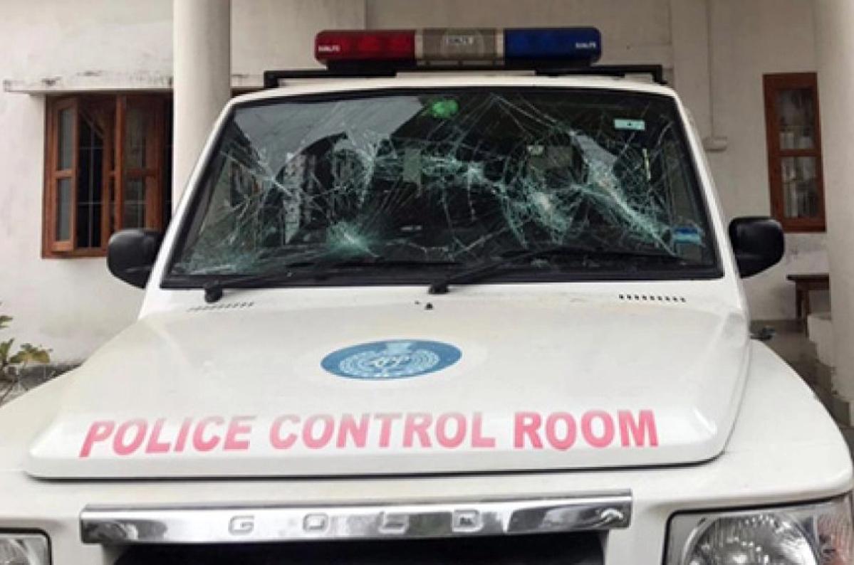 A damaged police vehicle at the Bomdila Police Station
